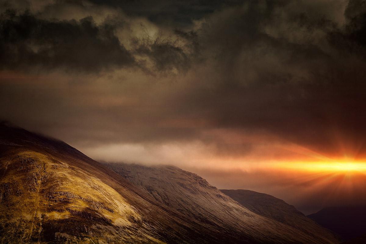 Sun Peaking Behind Mountains